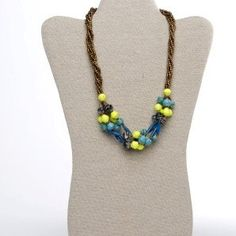 "Matooke Necklace - Blue.  This necklace is inspired by Ugandan traditional dish called ""Matooke"". The selection of colors allows playful and unique accessory to give some vibrant colors to a basic outfit. Made with strings with gold beads and recycled paper rolled beads. Available in two different color combinations that changes seasonaly."