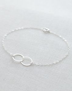 Simple Double Circle Bracelet by Olive Yew. Dainty linked circles bracelet in silver or gold.