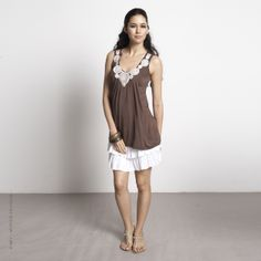 MEV - Mothers en Vogue - The Zahra Applique Tunic is a stylish piece from the Nursing collection. Designed in a relaxed yet shapely fit, this feminine and effortlessly chic top drapes nicely.   Made out of eco-friendly bamboo fabric that scores high on style and comfort.   Features soft pink embroidered applique detail on the neckline for a touch of luxe..   Constructed with side-seam nursing access for discreet breastfeeding.  #mothersenvogue