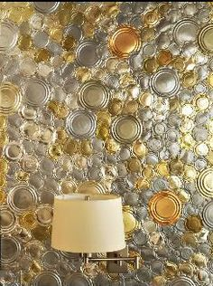 Can lid wall covering; could get from food cans, paint lids etc. Find a way to treat them to change the colour (vinegar possibly?) Have a light/candles to really make the most of it.