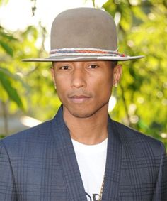Get Happy and Celebrate Pharrell Williams Birthday By Taking a Look at His Iconic Toppers  #InStyle