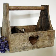 Neat little tote box with heart cutout from old fence or barn wood.