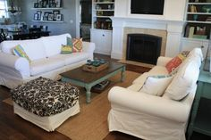 Fireplace, grey walls, white built in's, and white couches... Whats not to love?