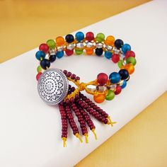 http://www.bostonbeadcompany.com/collections/classes/products/spice-trader-macrame-bracelet-by-erin-siegel