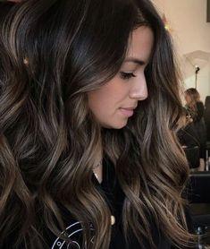 Dark brunette with subtle highlights
