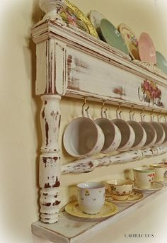 Take a footboard from a bed and transform it into a china display shelf for your kitchen