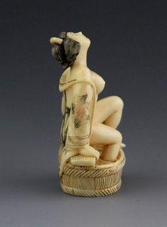JAPANESE CARVED IVORY NETSUKE BATHING GEISHA - by Manor Auctions