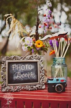 wedding photobooth table accessories, let people write notes on a chalk board they can take pictures with and add a cowboy hat. :)