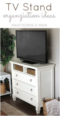 My TV stand was a mess!! Come see how I added more storage and got more organized.  It was super easy too!!