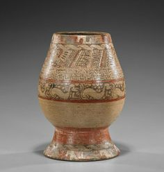 """A very unusual Costa Rican Pre-Columbian pottery vessel; a footed vessel with a gourd-shaped body and open mouth with a very elaborate design of stylized creatures and geometric shapes in concentric bands (repair to rim and foot); H: 9 1/4"""""""