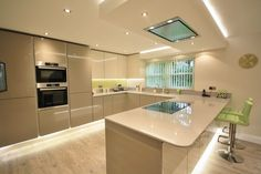 Open plan kitchen diner, peninsular separating the areas, Kitchen lighting can make all the difference.