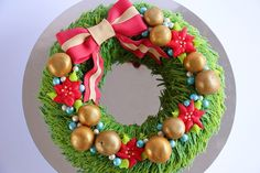 In this video tutorial I demonstrate how to create a beautiful Christmas wreath cake decorated using buttercream and cake pops. For more dessert inspiration ...