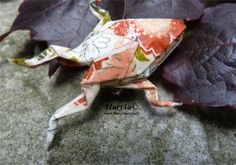 Pink origami frog.
