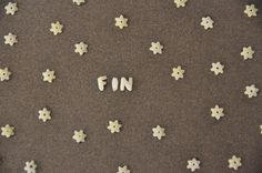Card made with soup letters and stars..