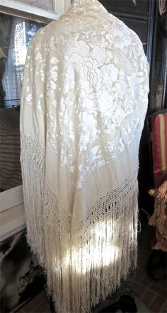 In absolutely perfect never-used condition, this gorgeous silk embroidered shawl…