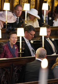 Anne smiling at her brother Prince Andrew at Prince Harry's wedding