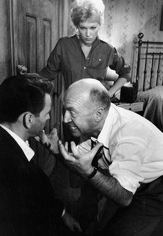 """Otto Preminger demonstrates to Kim Novak & Frank Sinatra on the set of """"The Man with the Golden Arm"""""""