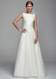 Demure and sophisticated this Mikado tank wedding dress is perfect for any classic bride!  Mikado tank boatneck bodice features delicate beaded lace applique detail.  Open back creates a stunning focal point.  Chapel train.  Fully lined. Back zip. Imported polyester. Dry clean. Cherish your wedding dress forever with our Gown Preservation Kit