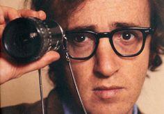 Woody Allen always seen in his iconic black nerd glasses.
