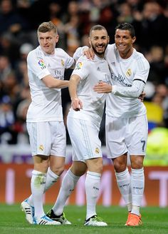 Karim Benzema of Real Madrid celebrates with Cristiano Ronaldo and Toni Kroos after scoring Real's opening goal during the La Liga match between Real Madrid CF and Sevilla FC at Estadio Santiago Bernabeu on March 20, 2016 in Madrid, Spain. (March 19, 2016 - Source: Denis Doyle/Getty Images Europe)