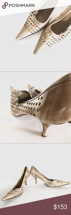 Prada Cutout Kitten Heel Size 39 Prada cutout Kitten Heel, size 39 (run small), color is cream and tan, see pics for condition, some scuffs on tips and Heel. Smoke free home. Prada Shoes Heels