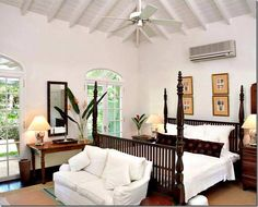 "Bedroom in the Plantation Wing at ""Fustic House"" on the island of Barbados. Architect Oliver Messler designed high ceilings with exposed rafters & beams, reminiscent of his Mustique houses."