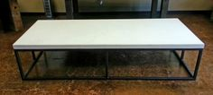 Custom Concrete Coffee table measuring 77x31x2 in Unground white on a Modern Base.  $2200   Call us today to customize a coffee table for your home!