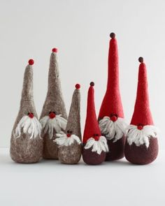 """Handmade in Nepal, these fanciful felted wool trolls infuse any room with a touch of jolly holiday spirit. Tilt the peak of the troll's tall hat for even more whimsy. Size: 16""""H"""