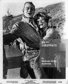 News Photo : John Wayne and Maureen O'Hara are covered in mud...
