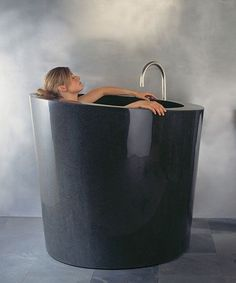 Tall Deep Soaking Bathtub--omg I want this, I dont know how Ill get in and out of it but I want it!!!