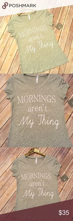 """Mornings graphic tee S-XL Graphic tee shirt that says """" mornings aren't my thing"""" soft stretchy comfy fabric. Fabric: 95% rayon 5% spandex. Fit: standard true to size women's fit. ( not unisex fit) . S-XL Tops Tees - Short Sleeve"""
