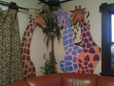 technicolor circus giraffes behind the couch.