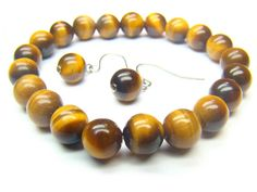Tigers Eye Round Shape 8mm Natural Crystal Bead Bracelet - See more at: http://waggashop.com/wagga-shop-tigers-eye-round-shape-8mm-natural-crystal-bead-bracelet