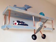 you can diy an airplane shelf for a boys room using to wood boards and copper pipes - Shelterness