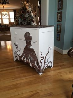 Hand Painted Octopus dresser.  Graphic was compliments of TheGraphicsFairy and the dresser was $40 from Habitat for Humanity Restore store,