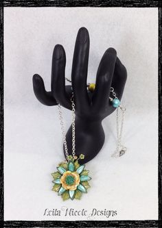 Springtime Collage Assemblage Blue Green  Yellow Flower Brass Spoon Spectra Bead Necklace - Blue To You on Etsy, $36.00