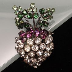 A turnip is not something you see every day in costume jewelry. In fact, this is the first time I've ever seen one. And, it's a cutie....silver tone metal with rhinestones. The reverse is hollow and t