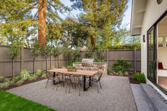 Traditional Patio with Fence, Wrap around porch, Outdoor kitchen, exterior stone floors, Premier Pebble Paving