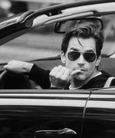 You know the scene in Fifty Shades Darker when Ana and Christian leave Dr. Flynn's office and are heading to the mansion? They argue and Christian takes over driving the Saab convertible. He is wearing his Ray Bans, and nervously chews his thumb while grilling Ana about what Dr, Flynn said....    http://fiftyshades.proboards.com