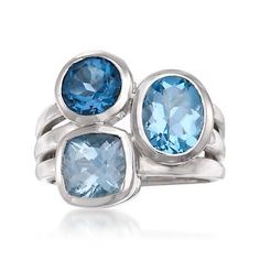 We love the gleaming display of color and shape in this blue topaz multi-band ring. Features round, oval and square-shaped topaz gemstones. Polished sterling silver ring. #stacked