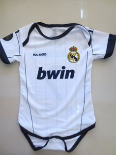 "REAL MADRID # 7 C. RONALDO BABY BODYSUIT SIZE FOR 12 TO 18 MONTHS .NEW.EXCELLENT QUALITY. by Eurosport. $24.95. REAL MADRID # 7 C RONALDO HOME  BABY BODYSUIT , 100% POLYESTER EXCELLENT QUALITY BRAND NEW ONESIES ARE SHORT SLEEVE these bodysuits offer velcro closure for easy dressing and diaper changing.Sublimed pictures and Signs SIZE FOR 12 TO 18 MONTHS: 10"" CHEST X 16"" LENGTH"
