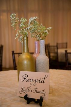DIY Wine Bottle Centerpieces Gold, White & Blush. Photographer: Sherry LaNell Photography Venue: The Orchard Event Venue www.theorchardtx.com. Hidden in a quiet corner of the Fort Worth metroplex is The Orchard, a new, state of the art venue that will serve as the perfect backdrop for all of life's special occasions. Outdoor Wedding Venue   Fort Worth Wedding Venue   Rustic Wedding Venue   Country Wedding Venue   Elegant Wedding Venue