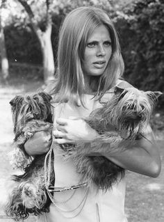 0 Britt Ekland with her two pet dogs, in the garden