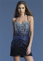 This short sparkling cocktail dress from Dave & Johnny is the perfect party dress with its skinny straps, lace up back, and crystals. #Homecoming Dresses www.GownGarden.com