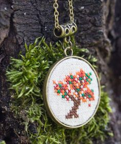 Autumn tree necklace - double-sided necklace with cross stitch and bronze trees
