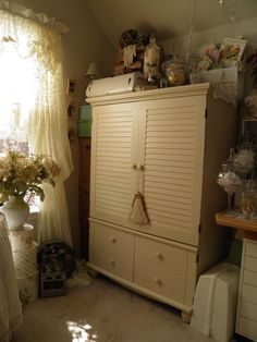 Vintage armoire used for my scrapbook studio