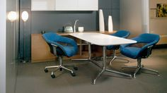 three blue SW-1 chairs around a meeting table -cropped
