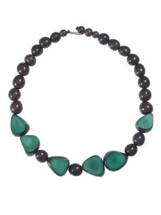 "Gemma Tagua Necklace $23.00 USD  -Gemma Necklace in Incan Sun, Hunter, and Quarry. -Made of Tagua Nut, Pambil & Acai seeds -Adjustable, 20"" in length -Produced following fair trade principles in Ecuador"