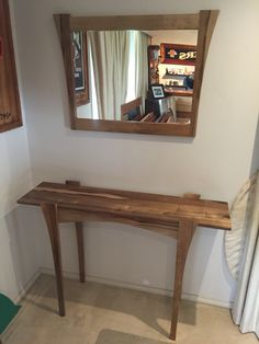 Black heart sassafras timber hall table and matching mirror
