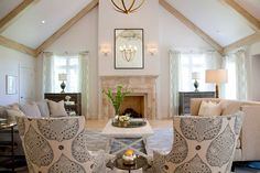 The focal point of the newly added family room is the brushed travertine fireplace. Photo by Jenifer Jordan.